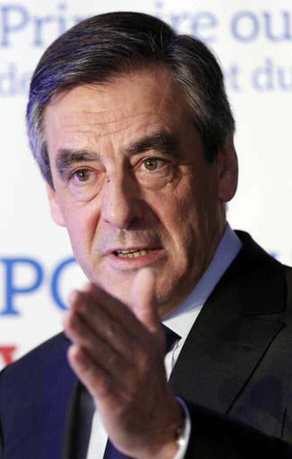 Francois Fillon delivers a speech after the conservative presidential primary in Paris, Sunday, Nov. 27, 2016. Fillon won France's first-ever conservative presidential primary after promising drastic free-market reforms and a crackdown on immigration and Islamic extremism, beating a more moderate rival who had warned of encroaching populism. (AP Photo/Christophe Ena) Photo: Christophe Ena