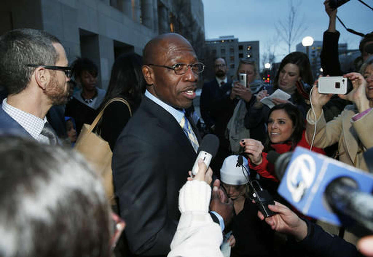 """FILE - In this Dec. 22, 2015, file photo, Clarence Moses-EL, center, talks after being released from Denver County jail in Denver. Moses-EL, released from prison last year after spending more than a quarter of a century in prison for a rape he long denied committing, was acquitted of the crime on Monday, Nov. 14, 2016, leaving a courtroom to applause from supporters and chants of """"it's over."""" (AP Photo/David Zalubowski, File)"""
