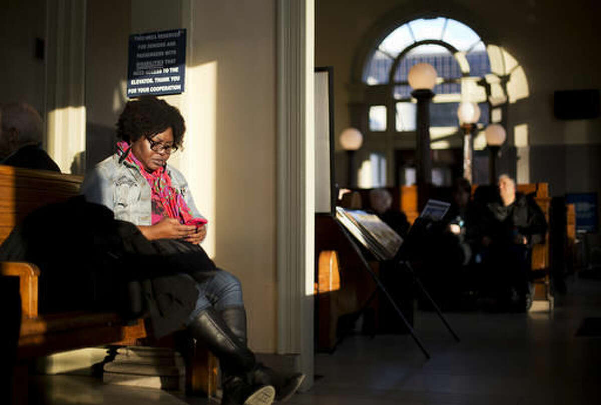 FILE - In this Wednesday, Nov. 25, 2015, file photo, Kendra Taylor waits in Atlanta to catch an Amtrak train to spend Thanksgiving in Decatur, Ala. The auto club AAA said Tuesday, Nov. 15, 2016, that it expects 1 million more Americans to venture at least 50 miles from home, a 1.9 percent increase over last year. (AP Photo/David Goldman, File)