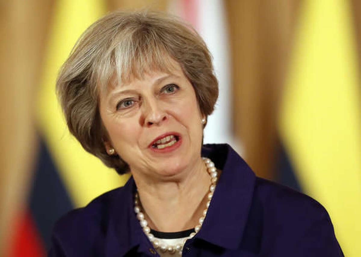 FILE - This is a Wednesday, Nov. 2, 2016 file photo of Britain's Prime Minister Theresa May speaks during a press statement with Colombia's President Juan Manuel Santos at 10 Downing Street in London. British Prime Minister Theresa May has shrugged off an adverse court ruling on the government's plans to leave the European Union and maintains that Brexit will be carried out in full. (AP Photo/Kirsty Wigglesworth, pool, File)