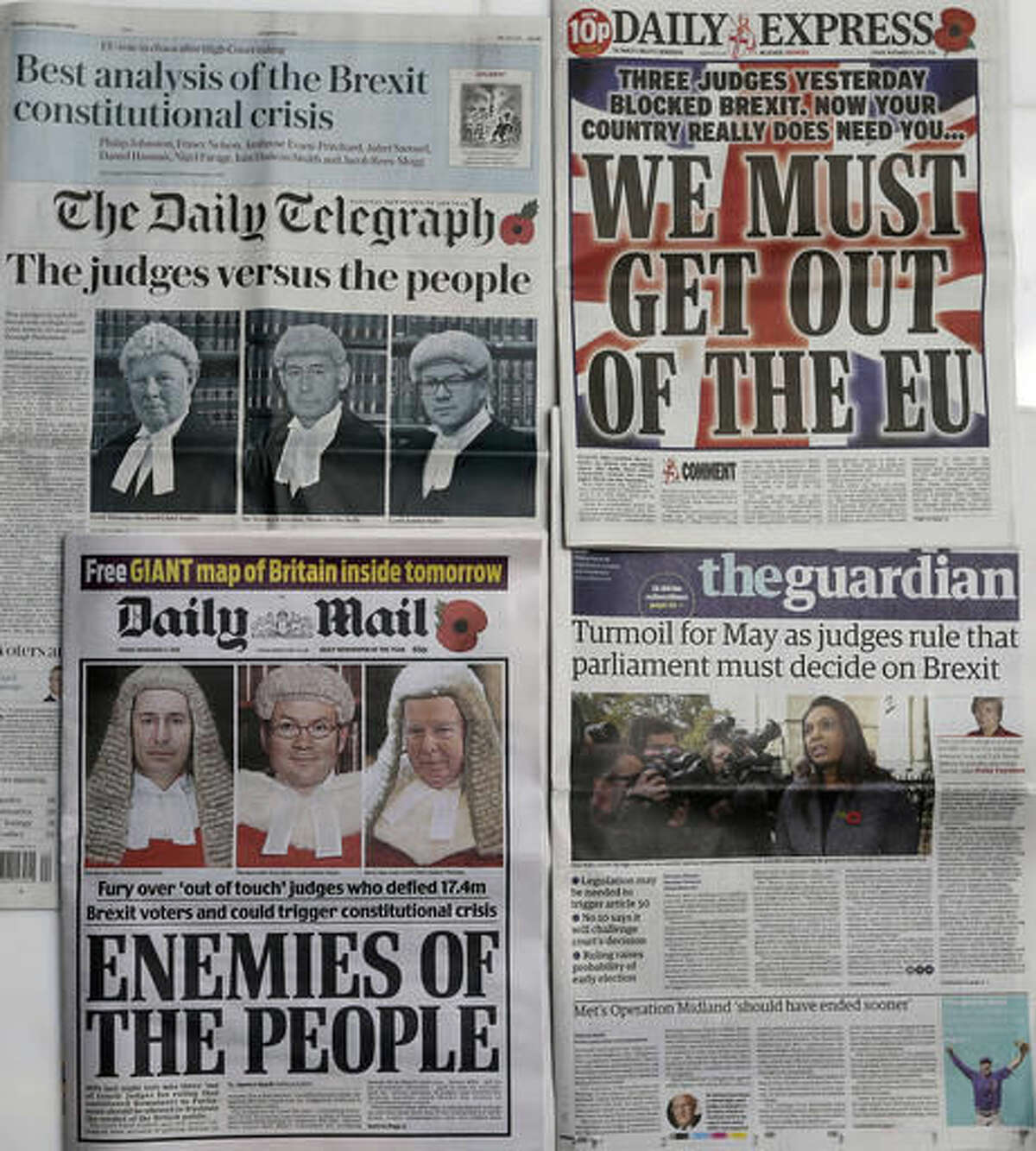 Some of the front pages of Britain's newspapers after the High Court determined that MPs must have a say on triggering Article 50 to begin the UK's exit from the European Union, in London, Friday Nov. 4, 2016. A High Court ruling that Britain's Parliament must give approval before Prime Minister Theresa May triggers the formal process of taking Britain out of the European Union has cast some uncertainty over Brexit. (AP Photo/Tim Ireland)