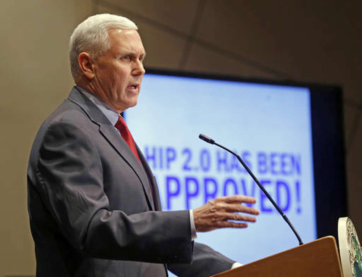 """FILE - In this Jan. 27, 2015, file photo, Indiana Republican Gov. Mike Pence announces that the Centers for Medicaid and Medicare Services had approved the state's waiver request, called HIP 2.0, during a speech in Indianapolis. Pence told Republican governors meeting in Florida on Nov. 14, 2016, that Donald Trump would replace traditional Medicaid funding to states with block grants that """"encourage innovation that better delivers health care to eligible residents,"""" according to a statement from the Trump transition team. (AP Photo/Michael Conroy, File)"""