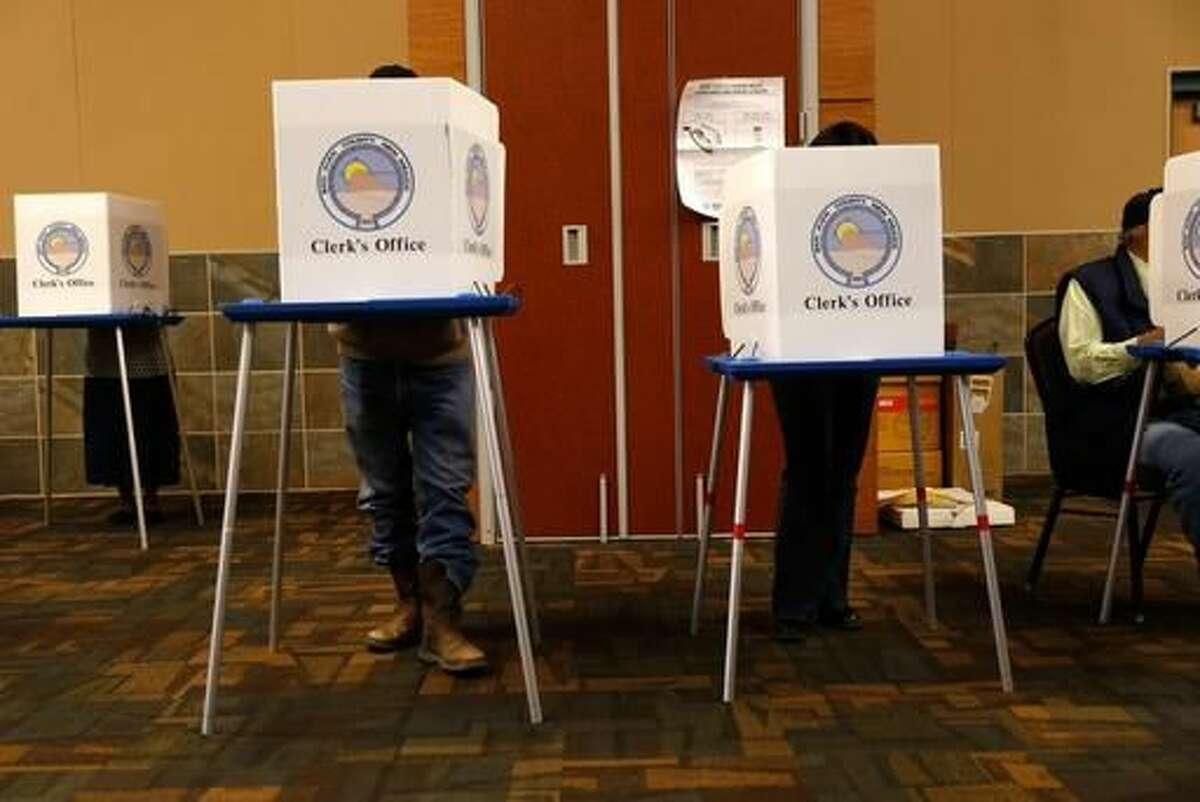 Voters fill in their ballots, Tuesday, Nov. 8, 2016 at the Farmington Civic Center in Farmington, NM. (Jon Austria/ The Daily Times via AP) /