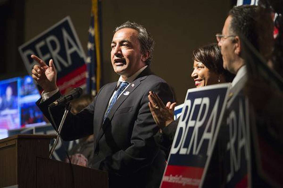 Rep. Ami Bera, D-Elk Grove, with wife Janine Bera, speaks at Elks Lodge with supporters as they await early election returns on Tuesday, Nov. 8, 2016 in Carmichael, Calif. (Scott Jones/The Sacramento Bee via AP)