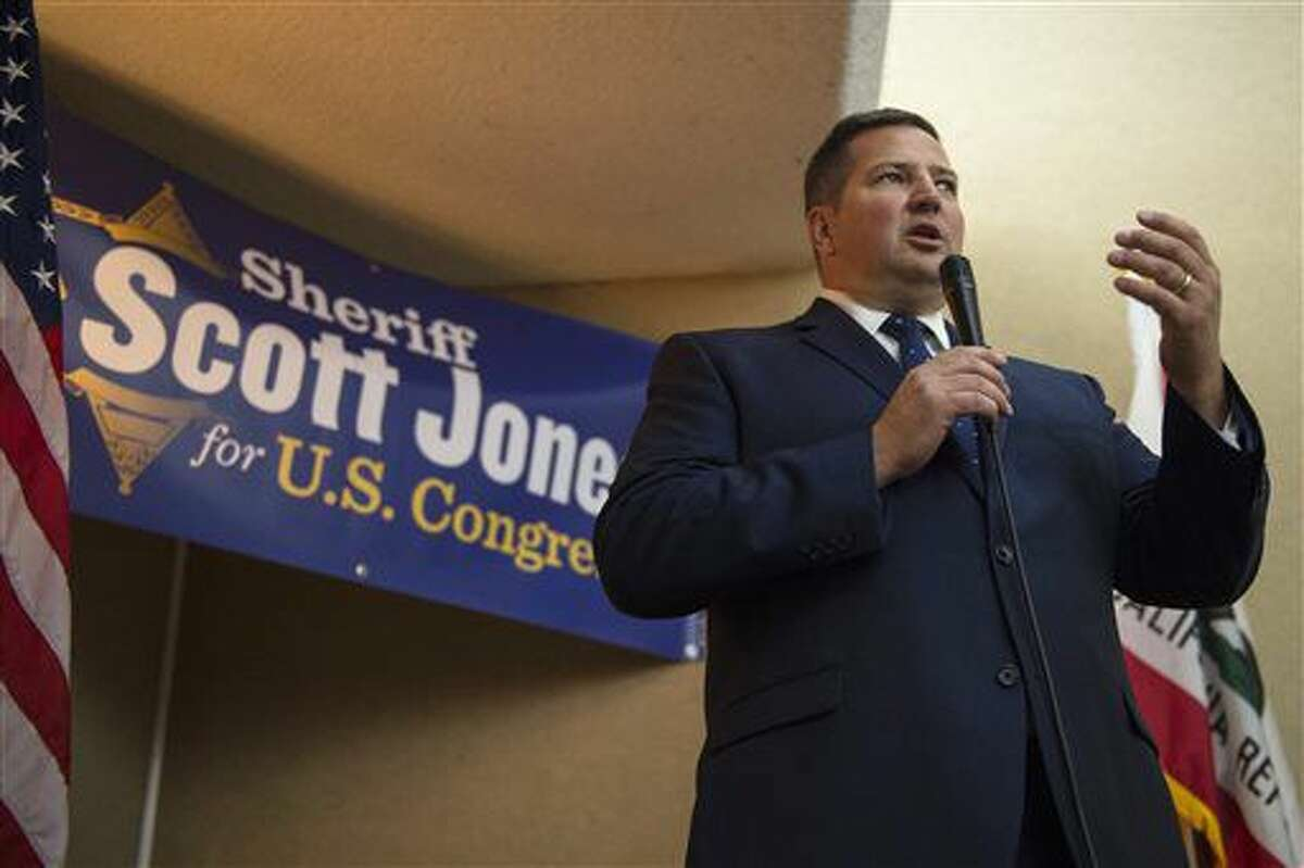 Republican candidate Sacramento County Sheriff Scott Jones, 49, thanks his supporters after waiting on election returns for his 7th Congressional race against opponent Rep. Ami Bera on Tuesday, Nov. 8, 2016, in Sacramento, Calif. (Renee C. Byer/The Sacramento Bee via AP)