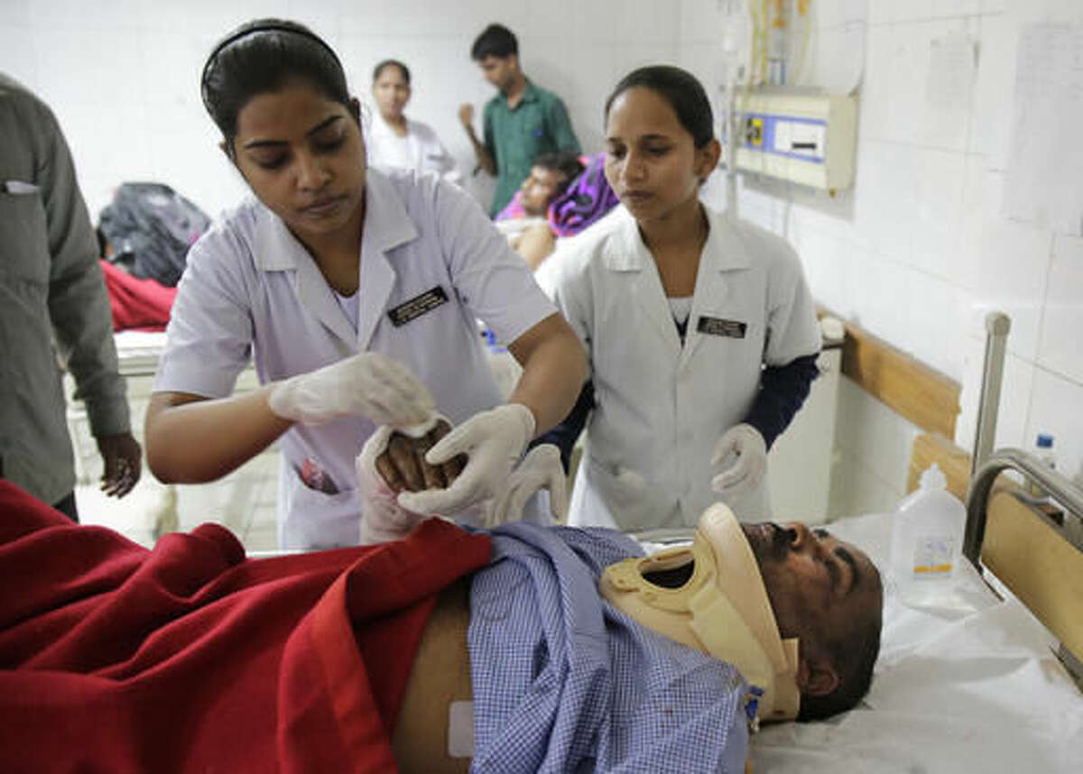 An injured passenger is treated at a hospital in Kanpur, in the northern Indian state of Uttar Pradesh, India, Monday, Nov. 21, 2016. Scores of passengers died and scores more were injured after 14 coaches of an overnight passenger train rolled off the track near Pukhrayan village in Kanpur Dehat district. (AP Photo/Rajesh Kumar Singh)