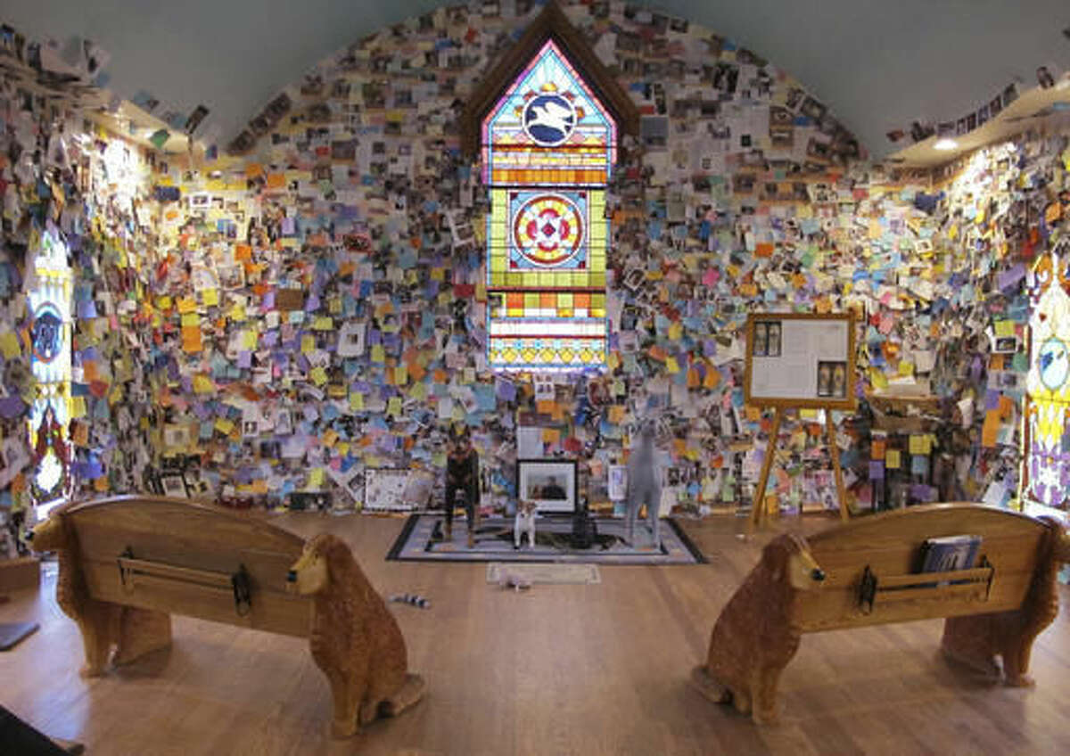 In this Nov. 16, 2016 photo the inside of the Dog Chapel at Dog Mountain shows where dog owners have grieved their lost pets by placing notes on the walls in St. Johnsbury, Vt. Dog Mountain is a 150-acre haven for canines that includes trails, several ponds, the chapel and a gallery of artwork by the site's late founder artist and children's book author Stephen Huneck. A Vermont group is trying to preserve the site that draws visitors from around the country and world. (AP Photo/Lisa Rathke)