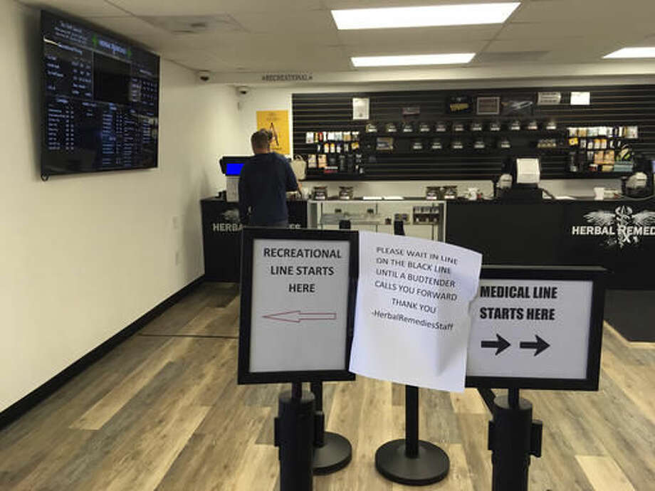 A customer is attended to inside the Herbal Remedies cannabis store Wednesday Nov. 9, 2016, just outside the Salem, Ore., city line in Marion County. Voters on Tuesday in a county-wide ballot decided to prohibit both retail and medical marijuana businesses in unincorporated parts of the county, putting the future existence of this shop in jeopardy. (AP Photo/Andrew Selsky) Photo: Andrew Selsky