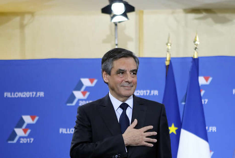 Francois Fillon puts his hand on his hear after delivering a speech following the conservative presidential primary Sunday, Nov. 27, 2016 in Paris. Fillon won France's first-ever conservative presidential primary Sunday after promising drastic free-market reforms and a crackdown on immigration and Islamic extremism, beating a more moderate rival who had warned of encroaching populism. (AP Photo/Kamil Zihnioglu) Photo: Kamil Zihnioglu