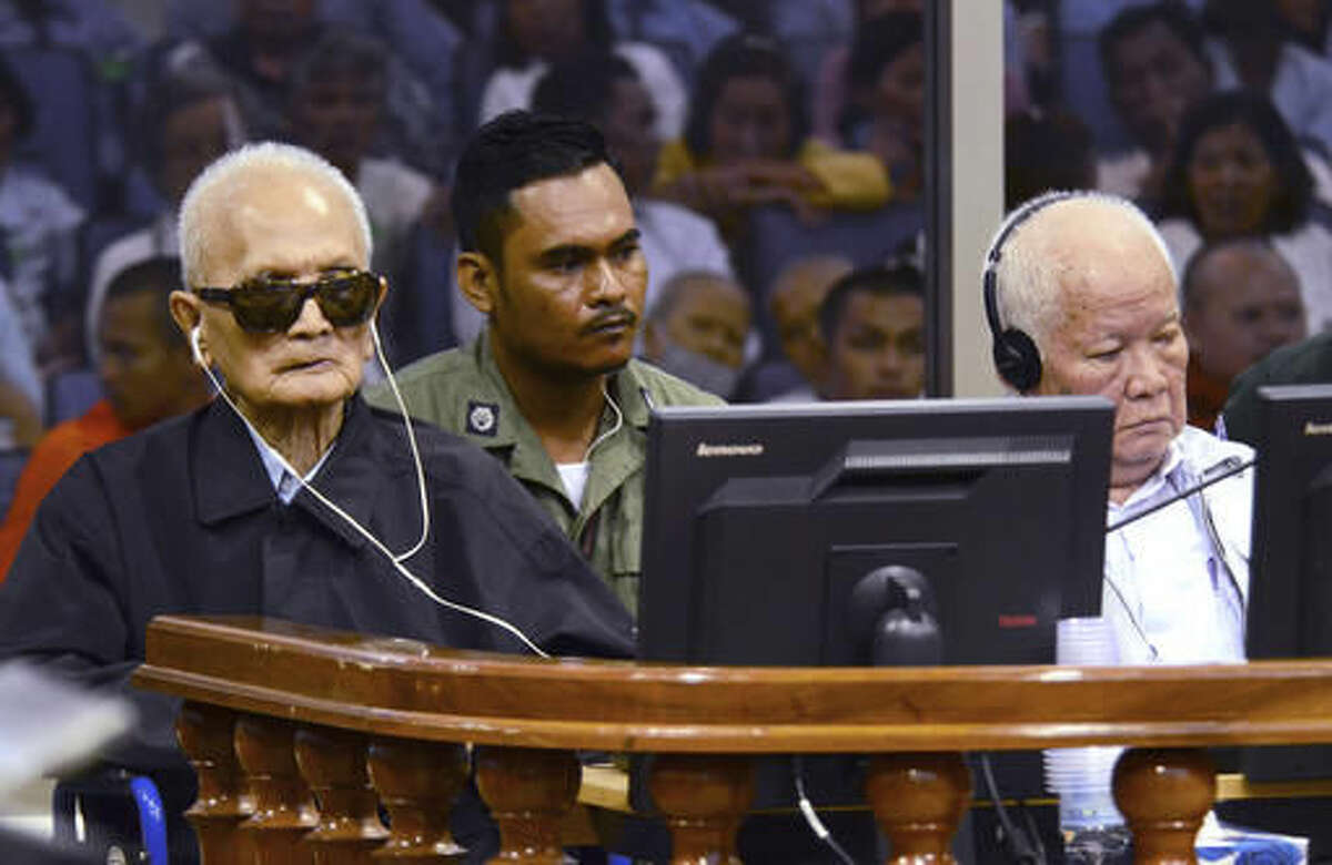 """In this photo released by the Extraordinary Chambers in the Courts of Cambodia, the two most senior surviving members of the Khmer Rouge regime Nuon Chea, left, and Khieu Samphan listen to the verdict which upheld their life sentences in Cambodia's top court, Phnom Penh, Cambodia, Wednesday, Nov. 23, 2016. The Supreme Court Chamber said the 2014 verdict by a U.N. assisted Khmer Rouge tribunal was """"appropriate"""" given the gravity of the crimes and roles of the two defendants, Chea, the 90-year-old right-hand man to the communist group's late leader Pol Pot, and Samphan, the 85-year-old Khmer Rouge head of state,. (Nhet Sok Heng/Extraordinary Chambers in the Courts of Cambodia via AP)"""