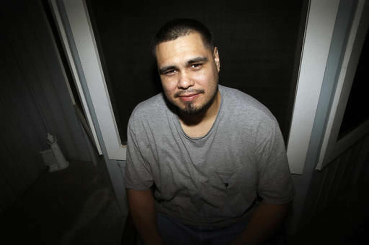 In this Tuesday, Sept. 6, 2016 photo, James Ochoa poses for a photo outside his home in Grand Prairie, Texas. Ochoa, who was on probation for drug possession when he was arrested for a carjacking, pleaded guilty to second-degree armed robbery and spent about a year in prison before DNA linked the carjacking to another man in 2006. Ochoa was cleared and released within days. More than 300 of the nearly 1,800 people who have been exonerated, or found innocent, since 1989 pleaded guilty even though they were innocent, according to an estimate by the National Registry of Exonerations. (AP Photo/LM Otero)