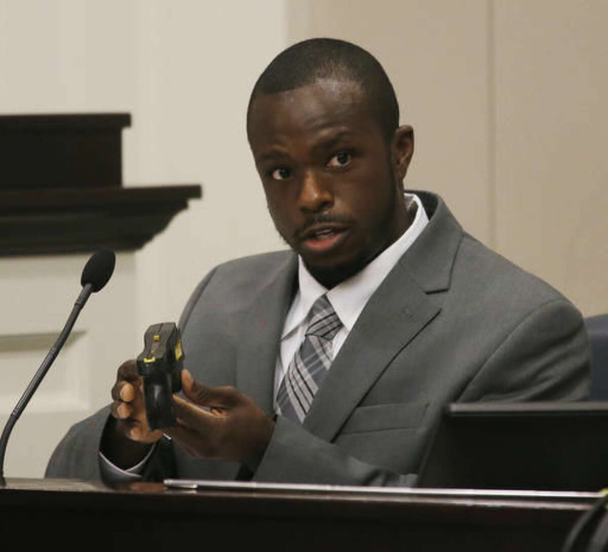 Samuel Stewart a DNA analyst from the South Carolina Law Enforcement Division speaks during the murder trial of former North Charleston Police Officer Michael Slager, Thursday, Nov. 10, 2016, in Charleston, S.C. Slager is on trial facing a murder charge in the shooting death of Walter Scott, who was gunned down after he fled from a traffic stop. Ninth Circuit Solicitor Scarlett Wilson is seen at left. (Grace Beahm/Post and Courier via AP, Pool)