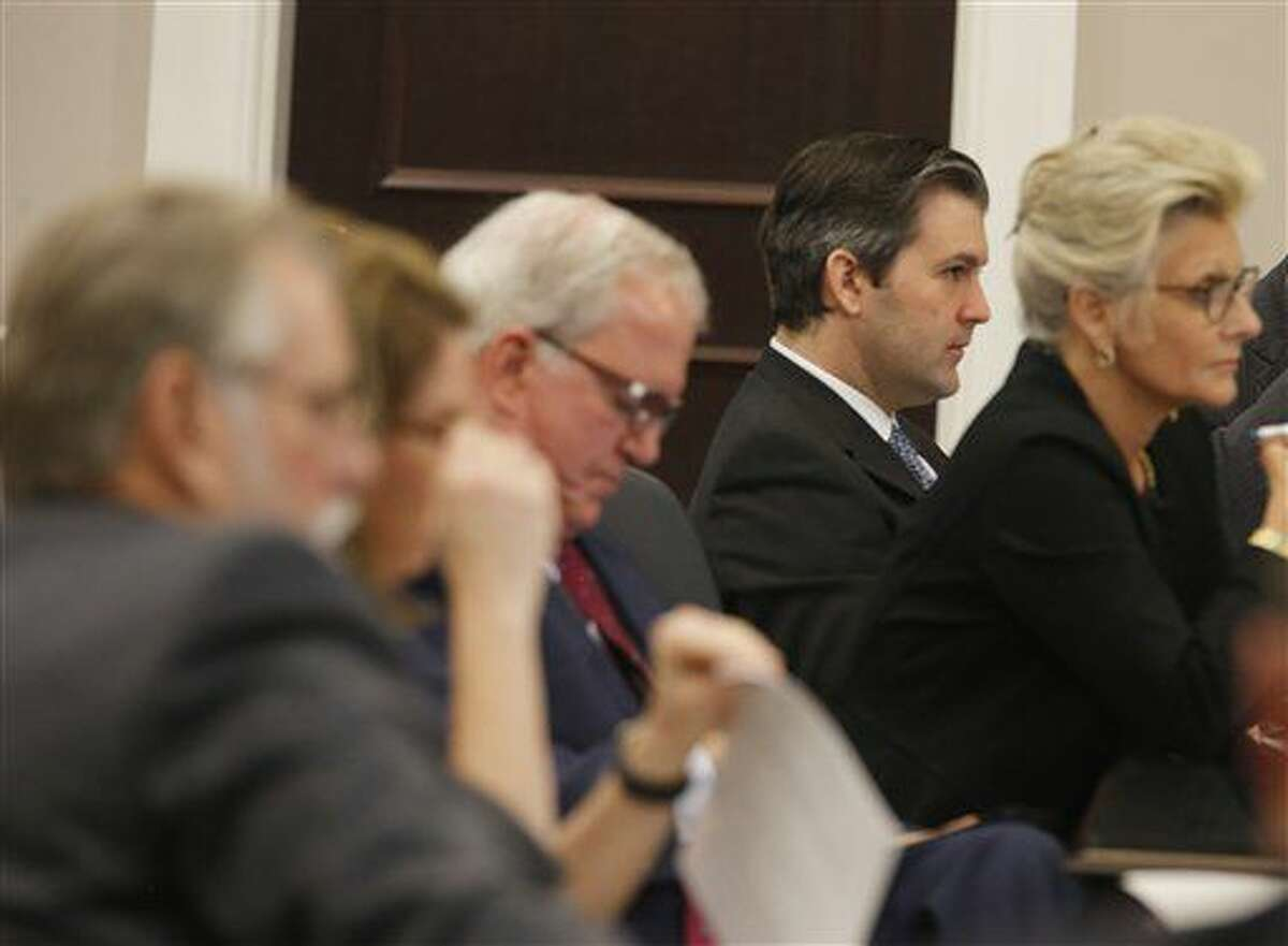 Former North Charleston Police Officer Michael Slager, second from right, sits at the defense table during testimony in Slager's murder trial, Thursday, Nov. 10, 2016, in Charleston, S.C. Slager is on trial facing a murder charge in the shooting death of Walter Scott, who was gunned down after he fled from a traffic stop. (Grace Beahm/Post and Courier via AP, Pool)