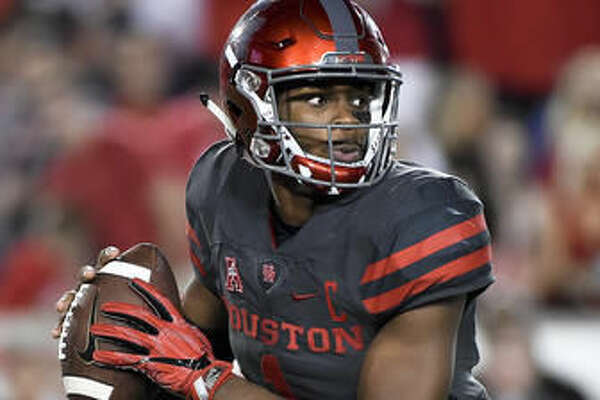 Houston quarterback Greg Ward Jr. scrambles during the second half of the team's NCAA college football game against Louisville, Thursday, Nov. 17, 2016, in Houston. Houston won 36-10. (AP Photo/Eric Christian Smith)