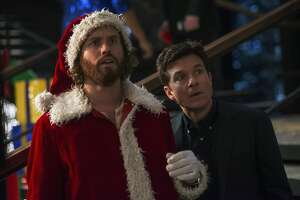 """This image released by Paramount Pictures shows T.J. Miller as Clay Vanstone, left, and  Jason Bateman as Josh Parker in a scene from """"Office Christmas Party."""" (Glen Wilson/Paramount Pictures via AP)"""
