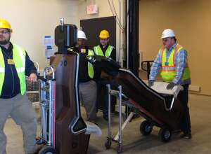 Slot machines are rolled off of the delivery truck at the Rivers Casino & Resort in Schenectady. The casino is expected to open on Feb. 8. Rivers Casino says the slot machines that arrived Tuesday morning are the region's first commercial slot machines. (Paul Nelson / Times Union)