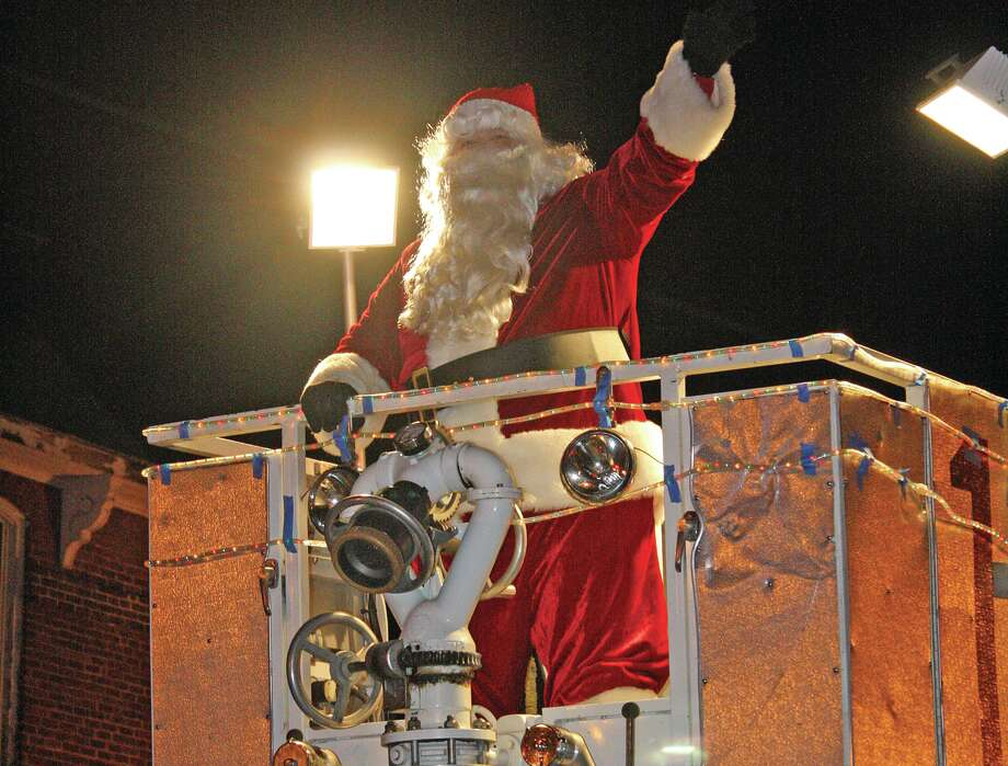 Santa Claus delights the crowd at Saturday's annual Harbor Beach Christmas Parade. Photo: Rich Harp/For The Tribune
