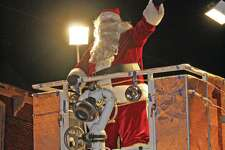 Santa Claus delights the crowd at Saturday's annual Harbor Beach Christmas Parade.