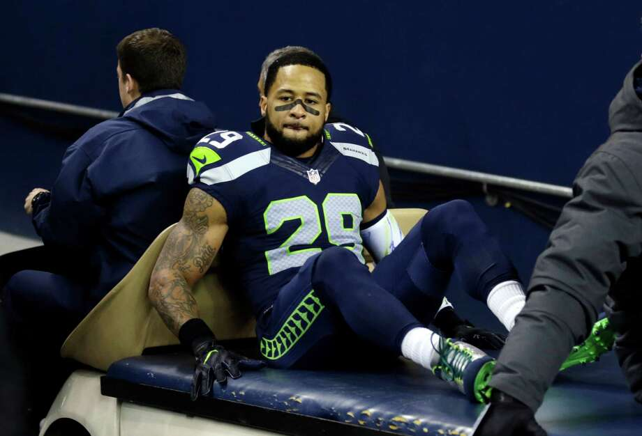Seattle Seahawks' Earl Thomas leaves the field on a cart after being injured against the Carolina Panthers in the first half of an NFL football game, Sunday, Dec. 4, 2016, in Seattle. (AP Photo/Stephen Brashear) Photo: Stephen Brashear, FRE / FR159797 AP