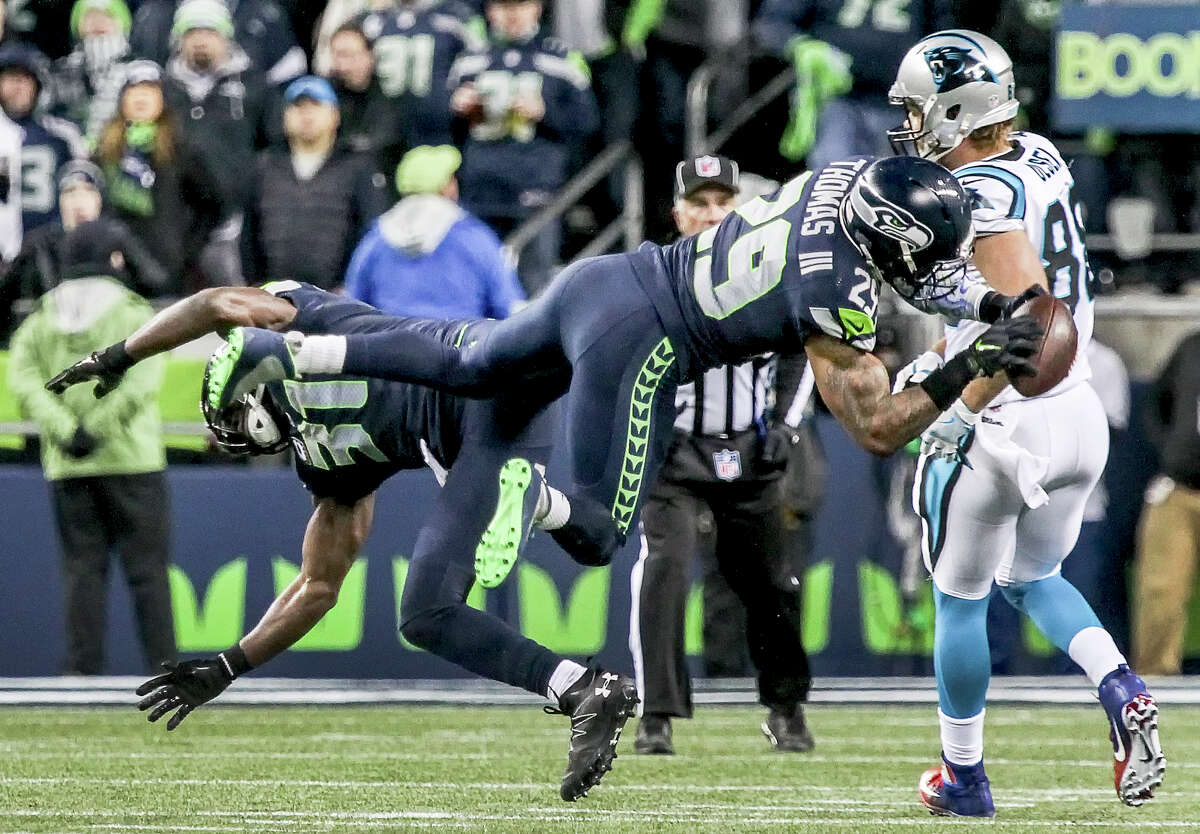 Seattle Seahawks safety Kam Chancellor, left, and Seahawks safety Earl Thomas collide on a pass during the first half of an NFL football game against the Carolina Panthers, Sunday, Dec. 4, 2016, in Seattle. (Kevin Clark/The Herald via AP)