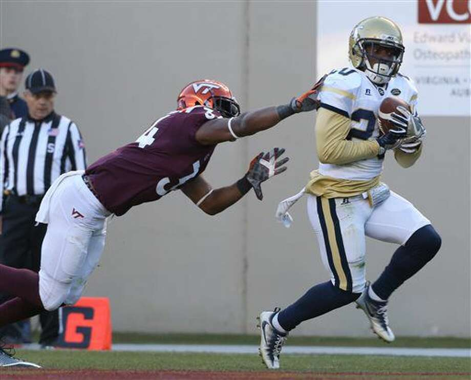 buy popular a1352 63c79 Georgia Tech safety Lawrence Austin (20) intercepts a pass in the endzone  in front
