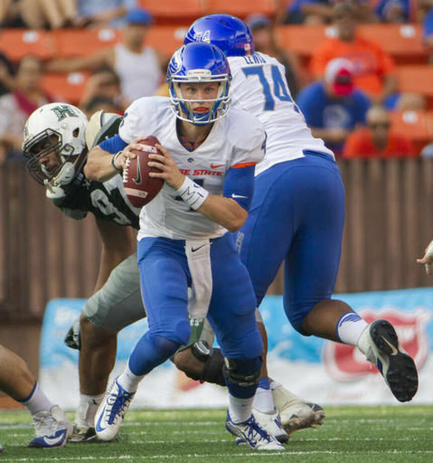 Boise State quarterback Brett Rypien (4) scrambles out of the backfield in the first half of an NCAA college football game against Hawaii, Saturday, Nov. 12, 2016, in Honolulu. (AP Photo/Eugene Tanner)