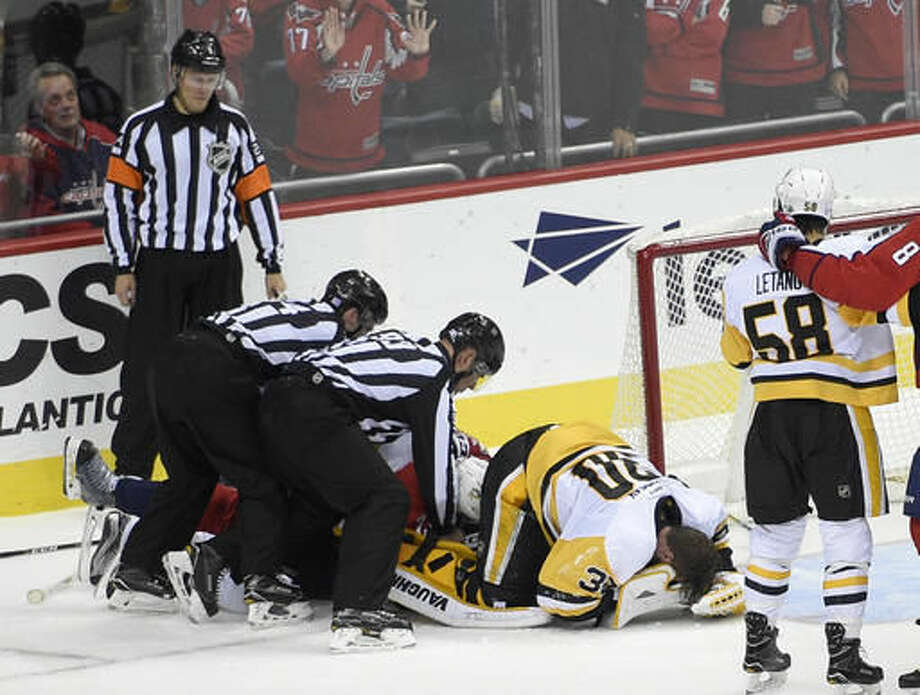 Pittsburgh Penguins goalie Matt Murray (30) lies on the ice after he was injured during the first period of an NHL hockey game against the Washington Capitals, Wednesday, Nov. 16, 2016, in Washington. Murray left the game. (AP Photo/Nick Wass)