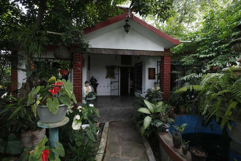 "This July 2, 2016 photo, shows the front entrance of Juan Carlos Soni Bulos' house in Tanquian de Escobedo, San Luis Potosi, Mexico. Soni says that when he was taken by Mexican Marines, he knelt before a wooden figure of Jesus outside his front door, kissed its feet and prayed: ""Lord, only you know where they are taking me. Help me return well."" (AP Photo/Marco Ugarte)"