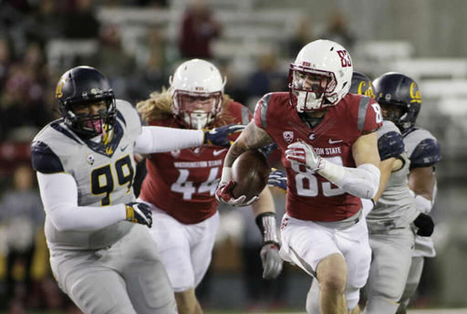 Washington State wide receiver Kaleb Fossum (83) returns a punt for a touchdown during the first half of an NCAA college football game against California in Pullman, Wash., Saturday, Nov. 12, 2016. (AP Photo/Young Kwak)
