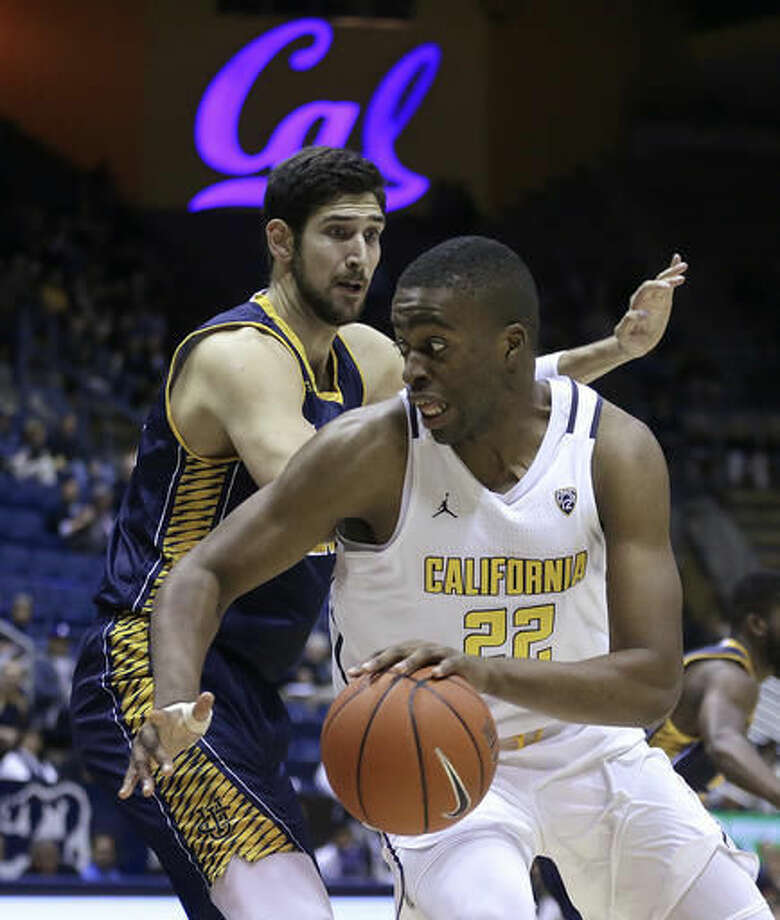 California's Kingsley Okoroh (22) drives the ball against UC Irvine's Ioannis Dimakopoulos during the first half of an NCAA college basketball game Wednesday, Nov. 16, 2016, in Berkeley, Calif. (AP Photo/Ben Margot)