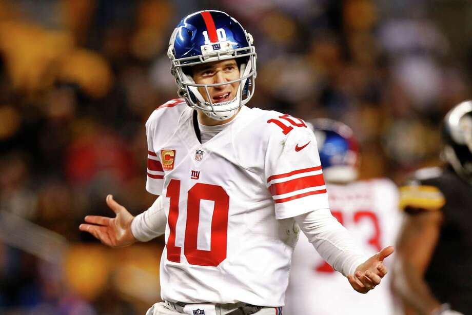 Eli Manning will not start at QB for the Giants on Sunday - the first time in 13 years he will not start a game. Photo: Jared Wickerham, Associated Press / FR171279