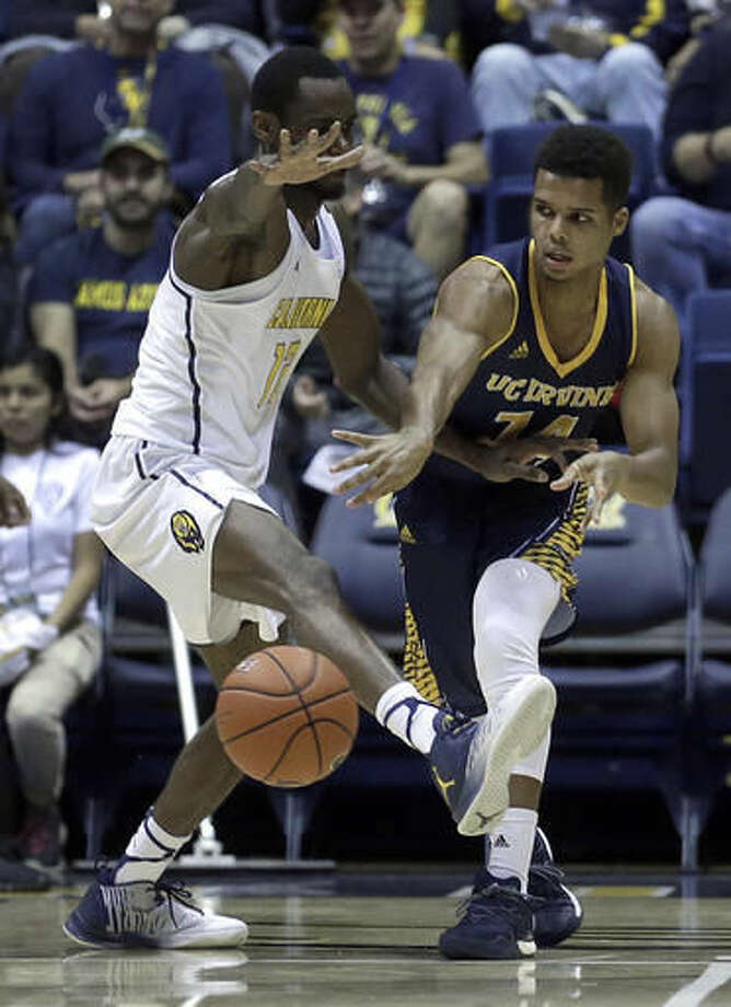 UC Irvine's Evan Leonard, right, passes away from California's Roger Moute A Bidias during the first half of an NCAA college basketball game Wednesday, Nov. 16, 2016, in Berkeley, Calif. (AP Photo/Ben Margot)
