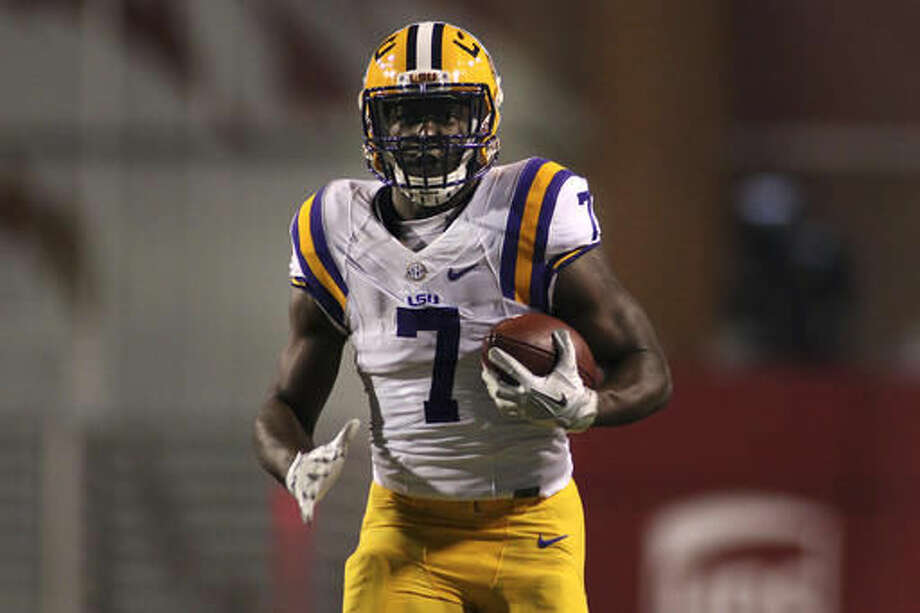 LSU's Leonard Fournette (7) rushes down the field during the first half of an NCAA college football game against Arkansas, Saturday, Nov. 12, 2016, in Fayetteville, Ark. (AP Photo/Samantha Baker)