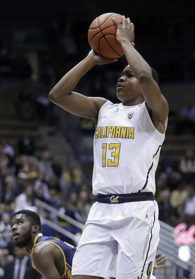 California's Charlie Moore shoots as UC Irvine's Max Hazzard watches during the first half of an NCAA college basketball game Wednesday, Nov. 16, 2016, in Berkeley, Calif. (AP Photo/Ben Margot)