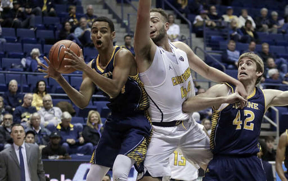 UC Irvine's Eyassu Worku, left, grabs a rebound next to California's Kameron Rooks during the first half of an NCAA college basketball game Wednesday, Nov. 16, 2016, in Berkeley, Calif. At right is UC Irvine's Tommy Rutherford (42). (AP Photo/Ben Margot)