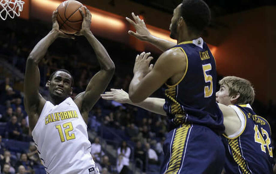 California's Roger Moute A Bidias, left, pulls in a rebound against UC Irvine's Jonathan Galloway (5) and Tommy Rutherford (42) in the first half of an NCAA college basketball game Wednesday, Nov. 16, 2016, in Berkeley, Calif. (AP Photo/Ben Margot)