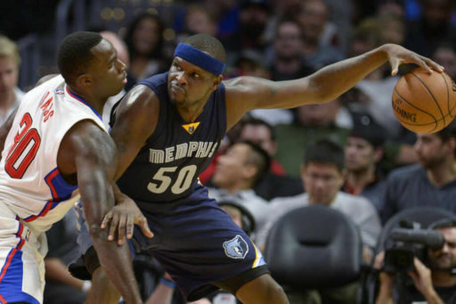 Memphis Grizzlies forward Zach Randolph (50) keeps the ball from Los Angeles Clippers' Brandon Bass during the first half of an NBA basketball game, Wednesday, Nov. 16, 2016, in Los Angeles. (AP Photo/Gus Ruelas)