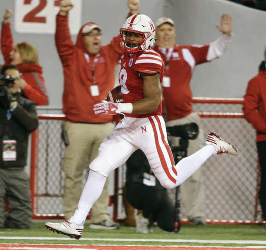 Nebraska running back Tre Bryant (18) runs into the end zone for a touchdown during the first half of an NCAA college football game against Minnesota in Lincoln, Neb., Saturday, Nov. 12, 2016. (AP Photo/Nati Harnik)