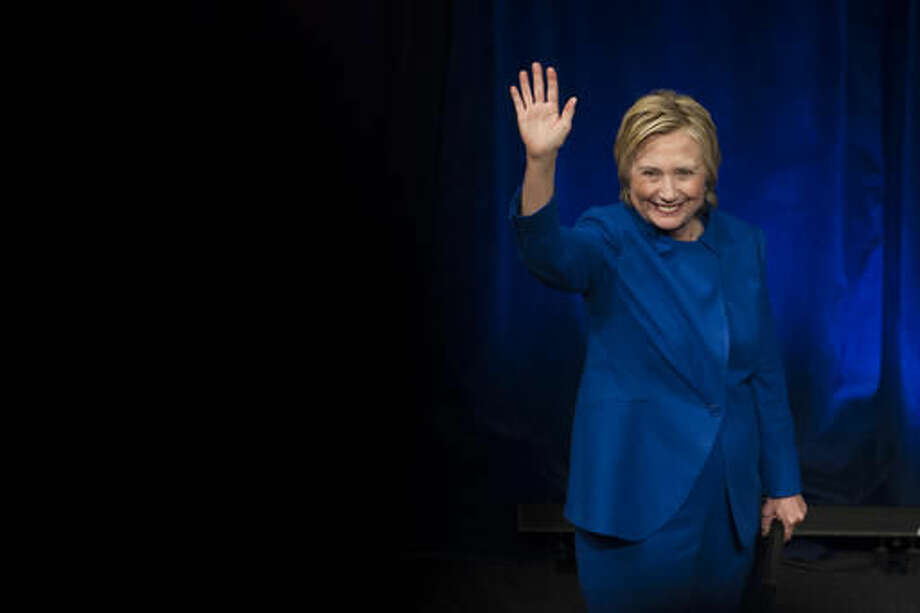 Hillary Clinton waves to the audience after addressing Children's Defense Fund's Beat the Odds celebration at the Newseum in Washington, Wednesday, Nov. 16, 2016. (AP Photo/Cliff Owen)