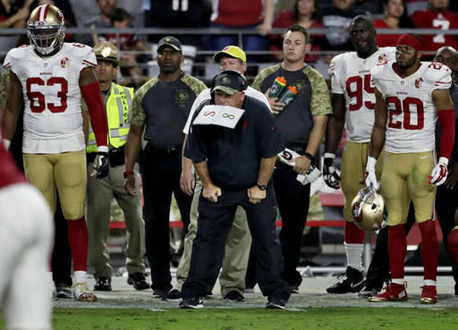 San Francisco 49ers head coach Chip Kelly and his bench watch as the Arizona Cardinals kick a game winning field goal during the second half of an NFL football game, Sunday, Nov. 13, 2016, in Glendale, Ariz. The Cardinals won 23-20. (AP Photo/Rick Scuteri)