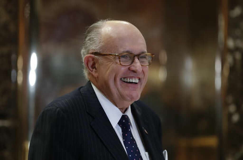 Former New York Mayor Rudy Giuliani arrives at Trump Tower, Wednesday, Nov. 16, 2016, in New York. (AP Photo/Carolyn Kaster)
