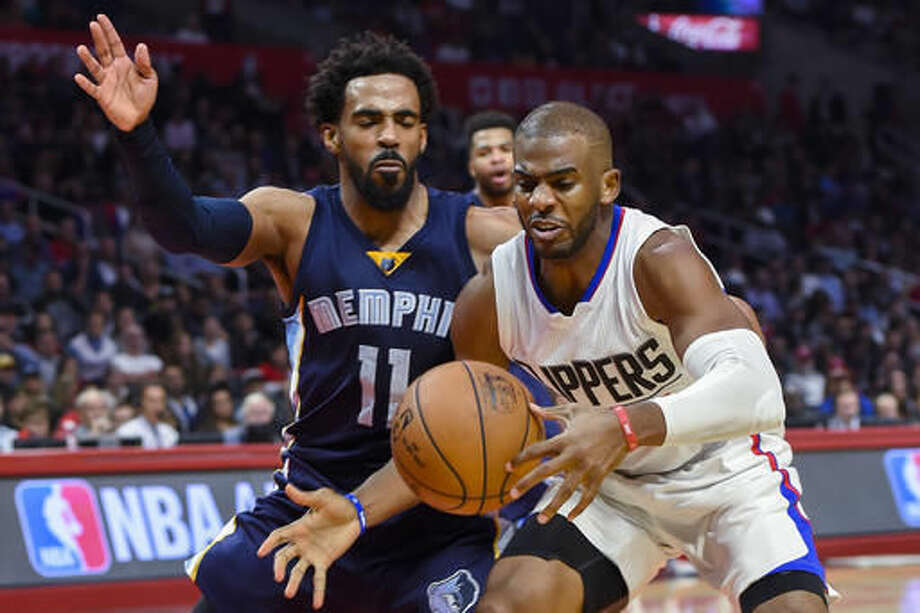 Memphis Grizzlies guard Mike Conley (11) defends as Los Angeles Clippers guard Chris Paul reaches for the ball during the first half of an NBA basketball game, Wednesday, Nov. 16, 2016, in Los Angeles. (AP Photo/Gus Ruelas)