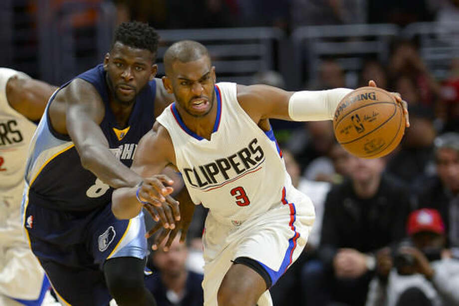 Los Angeles Clippers guard Chris Paul (3) drives by Memphis Grizzlies forward James Ennis (8) during the first half of an NBA basketball game, Wednesday, Nov. 16, 2016, in Los Angeles. (AP Photo/Gus Ruelas)