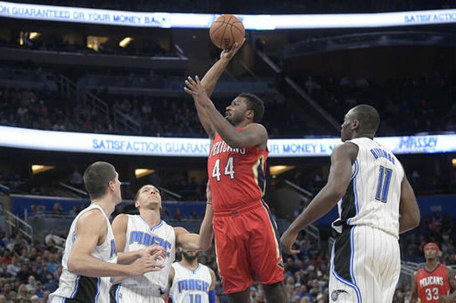 New Orleans Pelicans forward Solomon Hill (44) goes up for a shot between Orlando Magic forward Damjan Rudez, left, forward Aaron Gordon, second from left, and forward Bismack Biyombo (11) during the first half of an NBA basketball game in Orlando, Fla., Wednesday, Nov. 16, 2016. (AP Photo/Phelan M. Ebenhack)