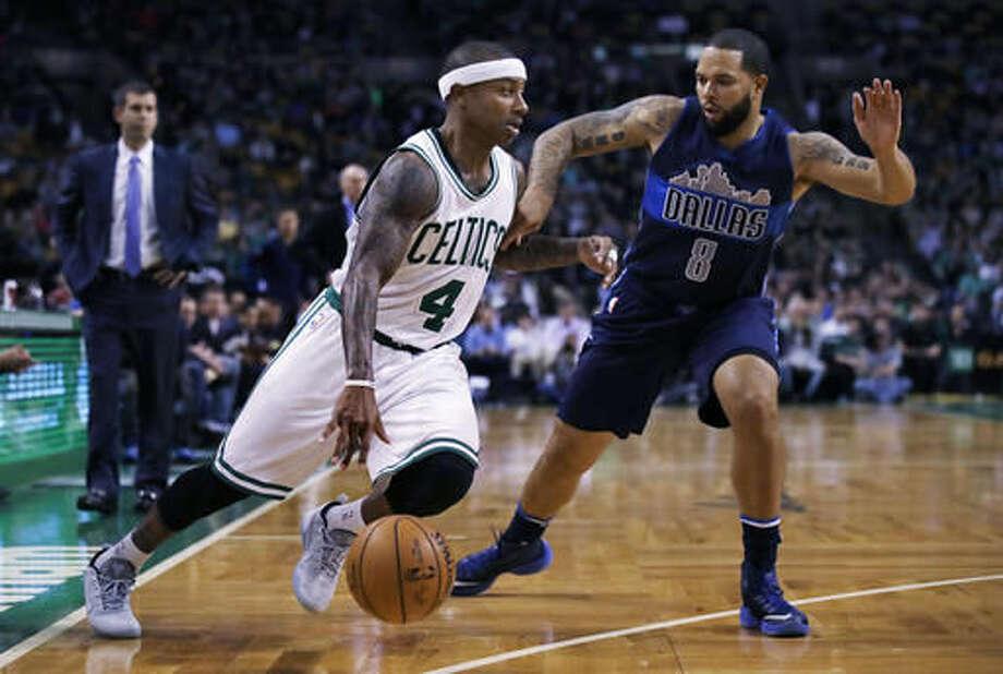 Boston Celtics guard Isaiah Thomas (4) drives to the basket against Dallas Mavericks guard Deron Williams (8) during the first quarter of an NBA basketball game in Boston, Wednesday, Nov. 16, 2016. (AP Photo/Charles Krupa)