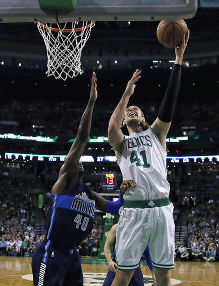 Boston Celtics center Kelly Olynyk (41) shoots over Dallas Mavericks forward Harrison Barnes (40) during the first quarter of an NBA basketball game in Boston, Wednesday, Nov. 16, 2016. (AP Photo/Charles Krupa)