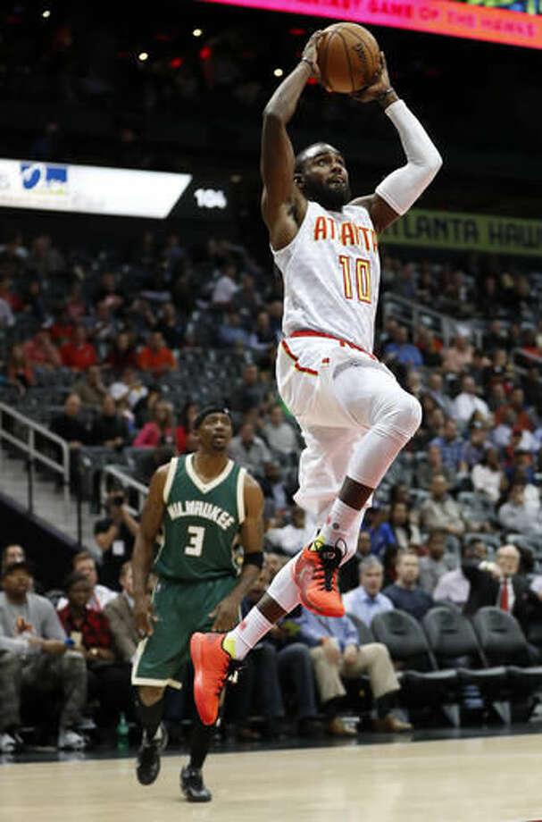 Atlanta Hawks guard Tim Hardaway Jr. (10) scores as Milwaukee Bucks guard Jason Terry (3) looks on in the first half of an NBA basketball game Wednesday, Nov. 16, 2016, in Atlanta. (AP Photo/John Bazemore)