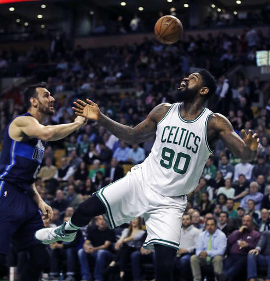 Boston Celtics forward Amir Johnson (90) looks up as he loses control of the ball next to Dallas Mavericks center Andrew Bogut (6) during the first quarter of an NBA basketball game in Boston, Wednesday, Nov. 16, 2016. (AP Photo/Charles Krupa)