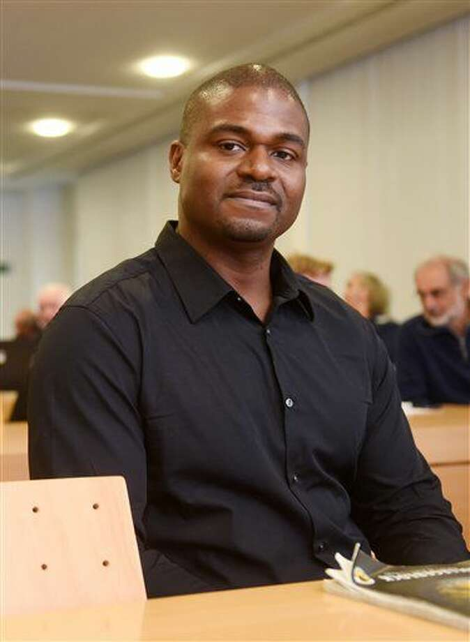 In this Nov. 16, 2016 picture the deserter and former USsoldier Andre Shepherd, right, waits in the courtroom of the administrative court in Munich, Germany, The court is hearing Shepherd's application for asylum. Shepherd's aylum request was not successful before the European Court in 2015. A Munich court has rejected Thursday Nov. 17, 2016 a U.S. soldier's asylum application in Germany, arguing that he hasn't exhausted all avenues to leave the military. Army Spc. Andre Shepherd deserted from his military base in southern Germany in 2007, claiming he wanted to avoid returning to Iraq where he feared being involved in war crimes. (Tobias Hase/dpa via AP)