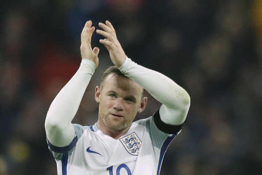 England's Wayne Rooney claps after winning the World Cup group F qualifying soccer match between England and Scotland with a 3-0 score at the Wembley stadium, London, Friday, Nov. 11, 2016. (AP Photo/Matt Dunham)
